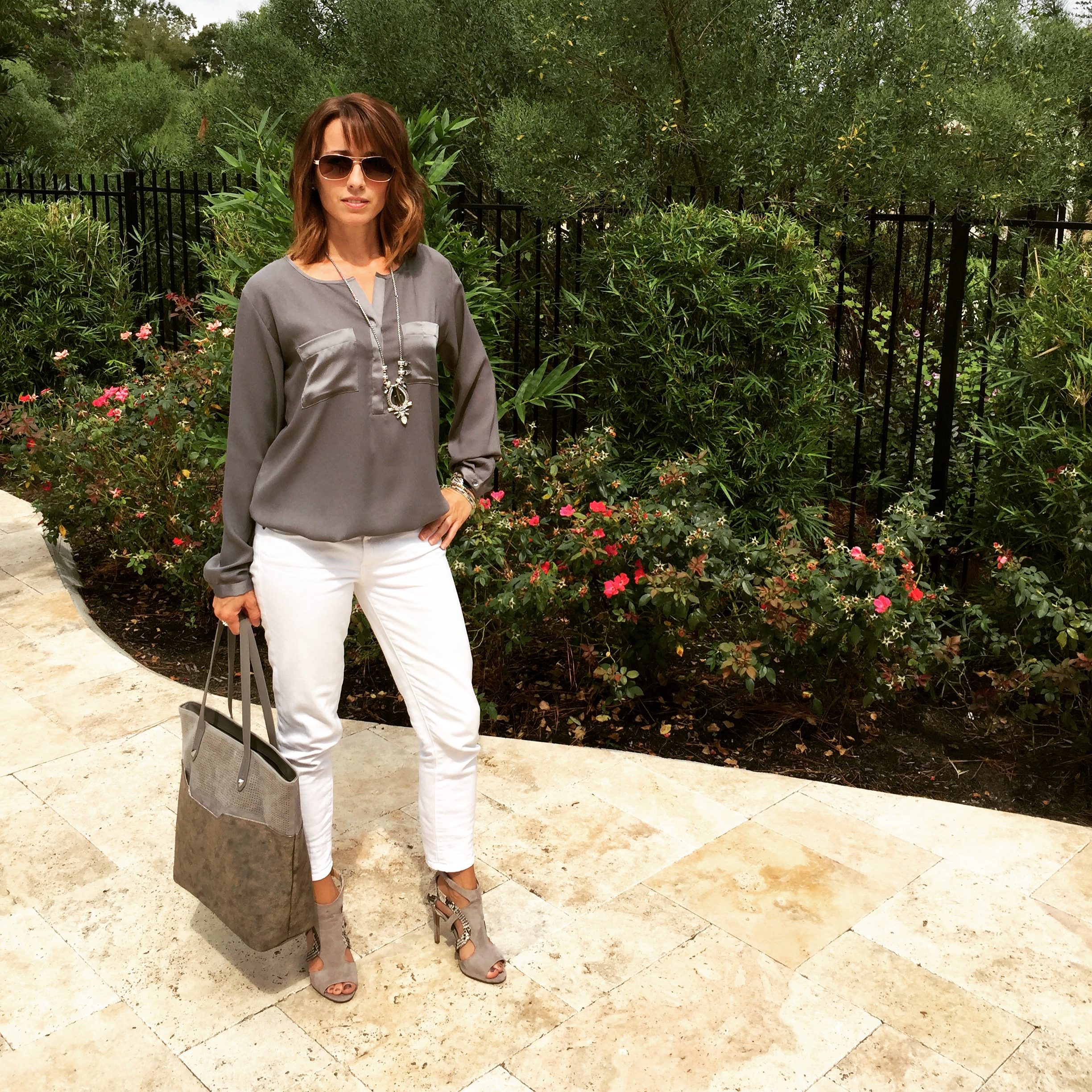 Grey blouse, white denim, suede and snake heels with silver accessories